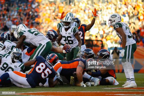 Fullback Andy Janovich of the Denver Broncos reaches the football across the goal line for a third quarter touchdown against the New York Jets at...