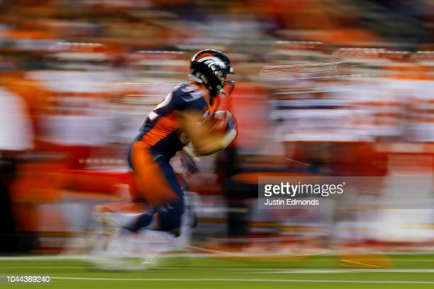 Fullback Andy Janovich of the Denver Broncos returns a kick in a slow shutter exposure against the Kansas City Chiefs at Broncos Stadium at Mile High...