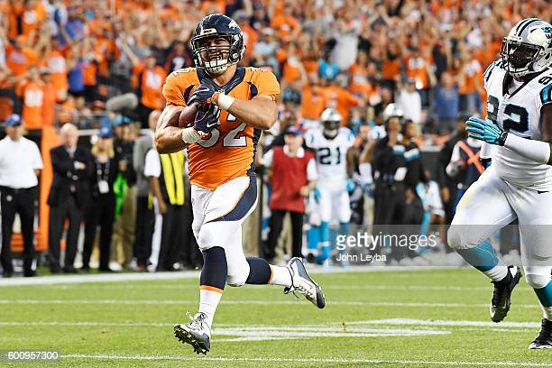 Fullback Andy Janovich of the Denver Broncos runs for a touchdown against the Carolina Panthers during the second quarter The Denver Broncos hosted...