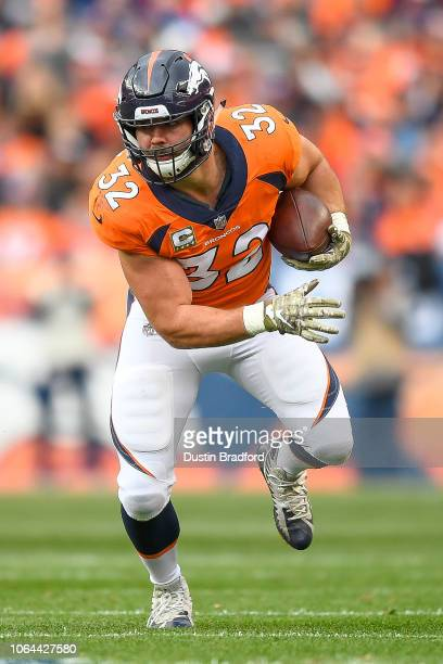 Fullback Andy Janovich of the Denver Broncos runs for yardage after a catch against the Houston Texans at Broncos Stadium at Mile High on November 4...