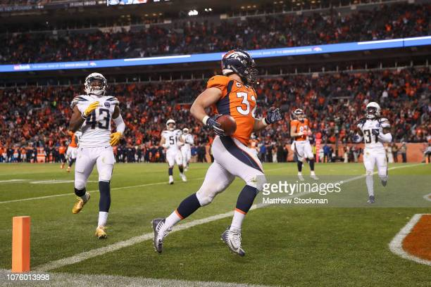 Fullback Andy Janovich of the Denver Broncos runs into the end zone with a fourth quarter touchdown against the Los Angeles Chargers at Broncos...