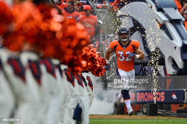 Fullback Andy Janovich of the Denver Broncos runs onto the field during player introductions before a game against the Cincinnati Bengals at Sports...