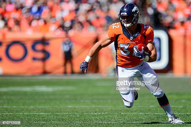Fullback Andy Janovich of the Denver Broncos runs the ball against the Indianapolis Colts at Sports Authority Field at Mile High on September 18 2016...