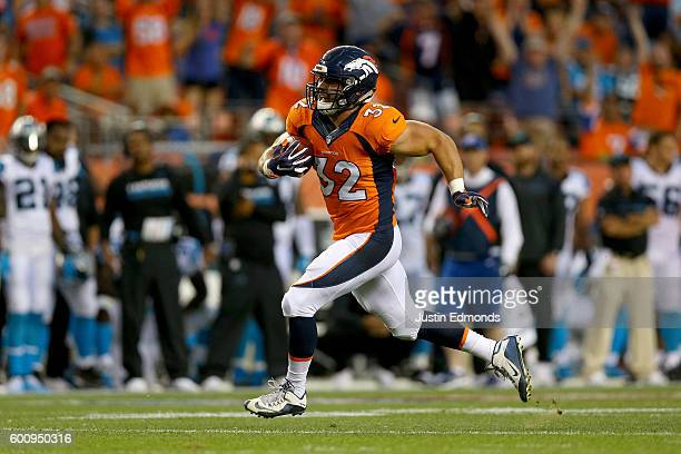 Fullback Andy Janovich of the Denver Broncos scores on a 28yard touchdown run against the Carolina Panthers in the second quarter at Sports Authority...