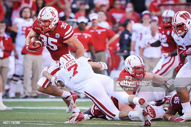 Fullback Andy Janovich of the Nebraska Cornhuskers breaks the tackle of safety Michael Caputo of the Wisconsin Badgers on the way to the end zone...