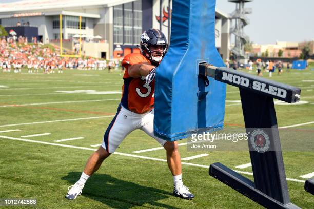 Fullback Andy Janovich peels off to hit the sled during drills at Denver Broncos training camp at the UCHealth Training Center August 7 2018 in...