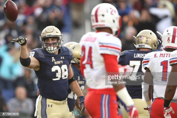 Fullback Anthony Gargiulo of the Navy Midshipmen celebrates a touchdown in the first quarter against the Southern Methodist Mustangs at NavyMarines...