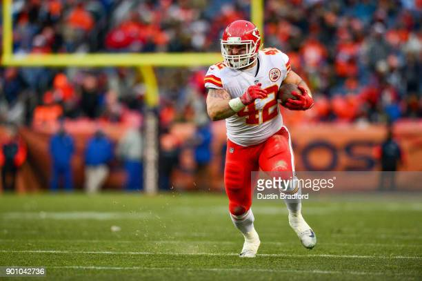 Fullback Anthony Sherman of the Kansas City Chiefs carries the ball against the Denver Broncos at Sports Authority Field at Mile High on December 31...