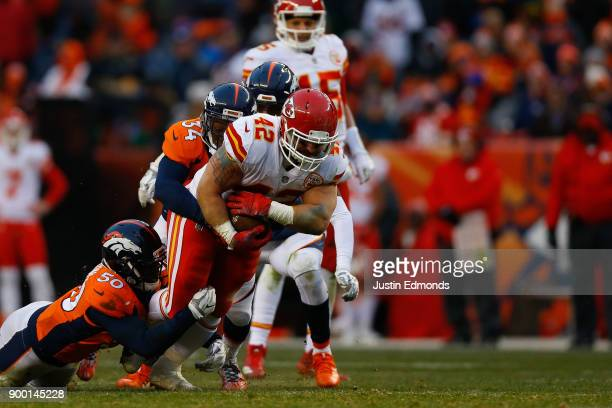 Fullback Anthony Sherman of the Kansas City Chiefs runs for a first down against inside linebacker Zaire Anderson and defensive back Will Parks of...