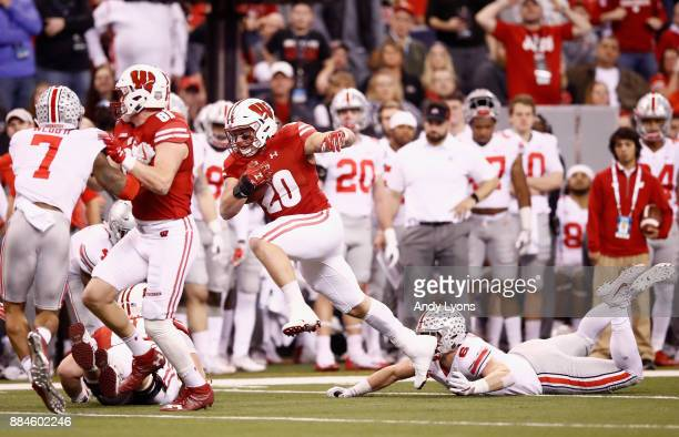 Fullback Austin Ramesh of the Wisconsin Badgers runs the ball escapting a tackle by defensive end Sam Hubbard of the Ohio State Buckeyes in the first...