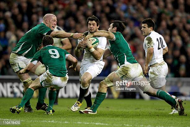 Fullback Ben Foden of England is tackled by Paul O'Connell and David Wallace of Ireland during the RBS 6 Nations Championship match between Ireland...