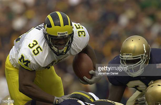 Fullback BJ Askew of Michigan carries the ball during the NCAA football game against Notre Dame at Notre Dame Stadium in South Bend Indiana on...