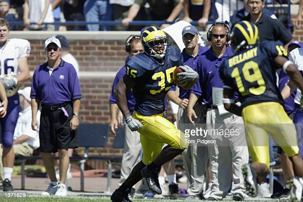 Fullback BJ Askew of Michigan runs down the sideline with the ball during the NCAA football game against the Washington Huskies at Michigan Stadium...