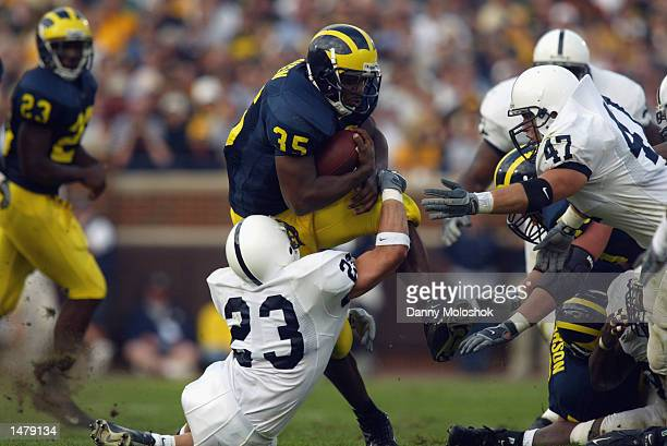 Fullback BJ Askew of the Michigan Wolverines tries to hurdle through saftey Shawn Mayer of the Penn St Nittany Lions on October 12 2002 at Michigan...