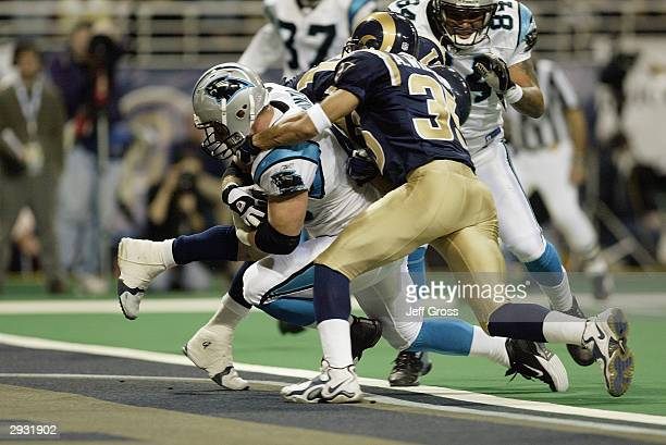 Fullback Brad Hoover of the Carolina Panthers is tackled after crossing the goal line for a touchdown during the NFC Divisional Playoff game against...