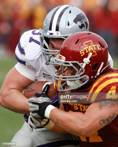 Fullback Braden Wilson of the Kansas State Wildcats makes helmet to hemet contact during the fourth quarter with linebacker A.J. Klein of the Iowa...