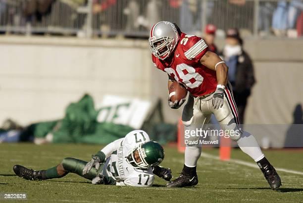 Fullback Branden Joe of the Ohio State University Buckeyes evades cornerback Roderick Maples of the Michigan State University Spartans at Ohio...