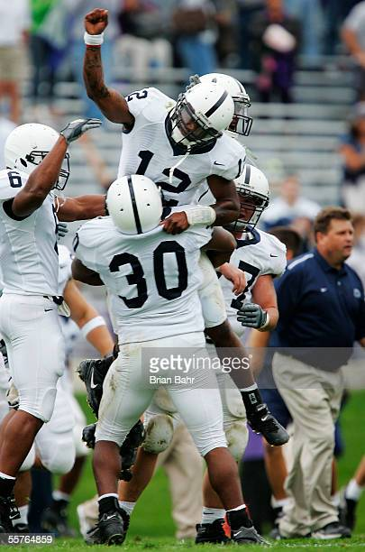 Fullback BranDon Snow lifts up quarterback Michael Robinson of the Penn State Nittany Lions after coming from behind to defeat the Northwestern...