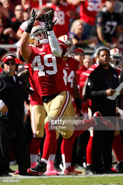 Fullback Bruce Miller of the San Francisco 49ers makes a catch for 52yards against the Baltimore Ravens during their NFL game at Levi's Stadium on...