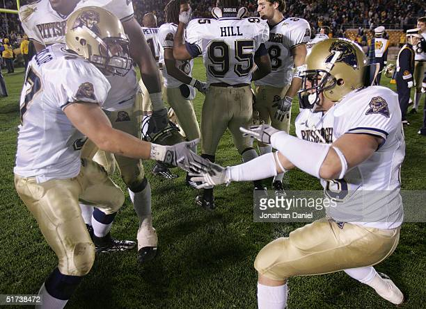 Fullback Chris McKillop and defensive back Doug Roseberry of Pittsburgh celebrate a lastsecond win over Notre Dame after a game on November 13 2004...