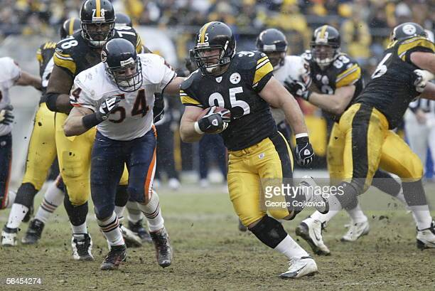Fullback Dan Kreider of the Pittsburgh Steelers is chased by linebacker Brian Urlacher of the Chicago Bears at Heinz Field on December 11, 2005 in...