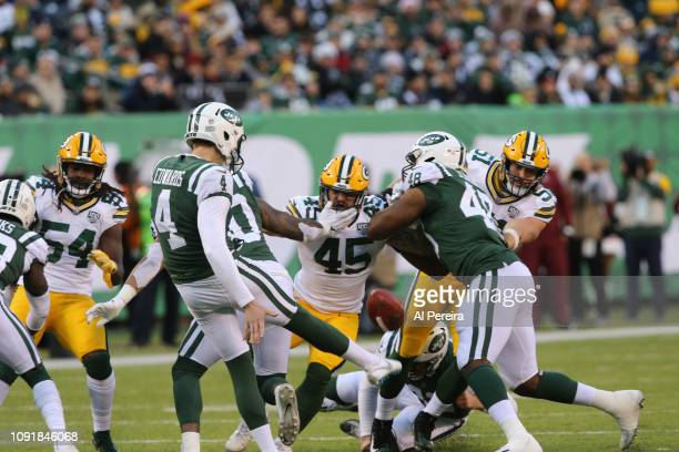 Fullback Danny Vitale and Linebacker Kyler Fackrell of the Green Bay Packers make a stop against the New York Jets at MetLife Stadium on December 23,...