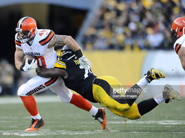 Fullback Danny Vitale of the Cleveland Browns is tackled by defensive tackle Javon Hargrave of the Pittsburgh Steelers during a game on January 1,...