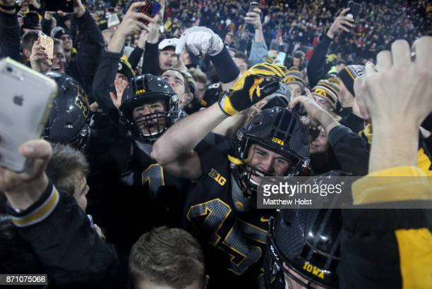 Fullback Drake Kulick of the Iowa Hawkeyes navigates swarming fans after the upset against the Ohio State Buckeyes on November 04 2017 at Kinnick...