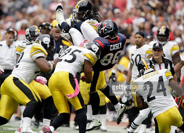 Fullback James Casey of the Houston Texans is upended by safety Troy Polamalu of the Pittsburgh Steelers on October 2 2011 at Reliant Stadium in...