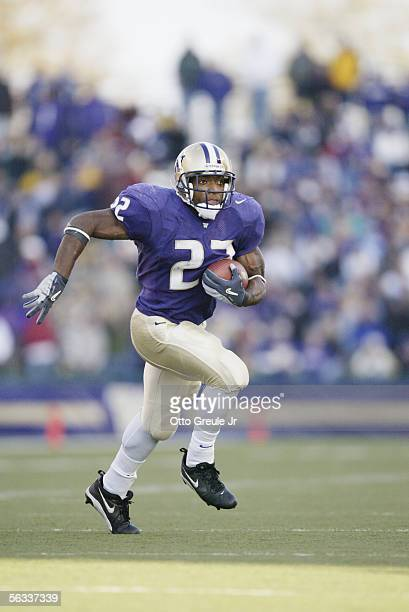 Fullback James Sims Jr #22 of the Washington Huskies carries the ball against the Washington State Cougars at Husky Stadium on November 19 2005 in...