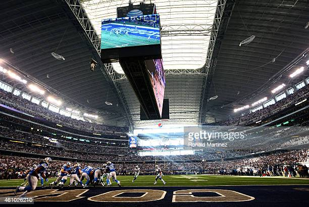 Fullback Jed Collins of the Detroit Lions runs the ball in the first half against the Dallas Cowboys during the NFC Wildcard Playoff Game at AT&T...