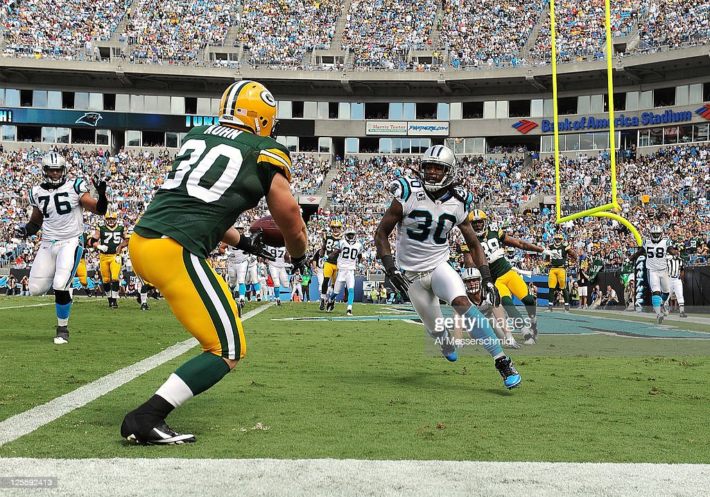 Fullback John Kuhn #30 of the Green Bay Packers drops a pass in the end zone against the Carolina Panthers September 18, 2011 at Bank of America Stadium in Charlotte, North Carolina.