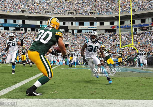 Fullback John Kuhn of the Green Bay Packers drops a pass in the end zone against the Carolina Panthers September 18 2011 at Bank of America Stadium...