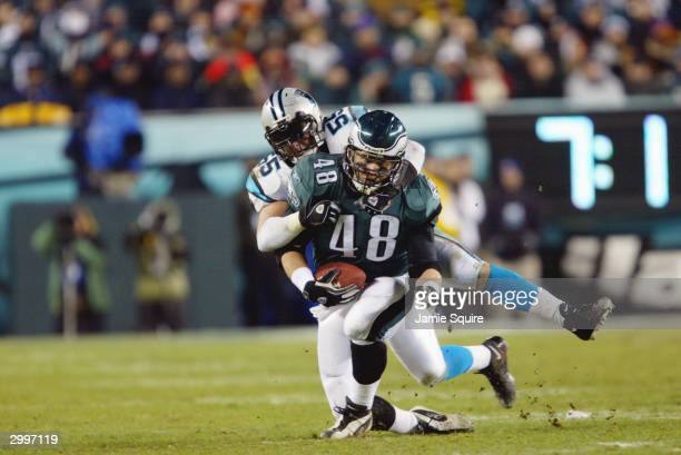 Fullback Jon Ritchie of the Philadelphia Eagles is tackled by linebacker Dan Morgan of the Carolina Panthers in the NFC Championship game on January...