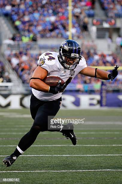 Fullback Kyle Juszczyk of the Baltimore Ravens carries the ball against the New Orleans Saints during a preseason game at MT Bank Stadium on August...