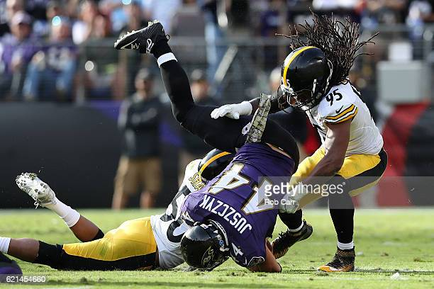 Fullback Kyle Juszczyk of the Baltimore Ravens is tackled by inside linebacker Ryan Shazier and outside linebacker Jarvis Jones of the Pittsburgh...