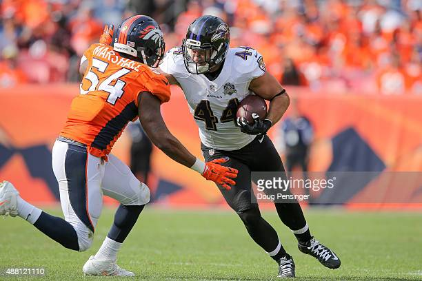 Fullback Kyle Juszczyk of the Baltimore Ravens rushes against outside linebacker Brandon Marshall of the Denver Broncos in the third quarter of a...