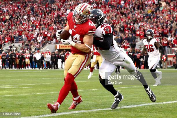 Fullback Kyle Juszczyk of the San Francisco 49ers catches a touchdown in the fourth quarter over linebacker Deion Jones of the Atlanta Falcons during...