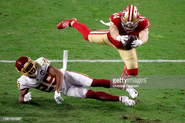 Fullback Kyle Juszczyk of the San Francisco 49ers dives into the end zone for a touchdown over cornerback Kendall Fuller of the Washington Football...