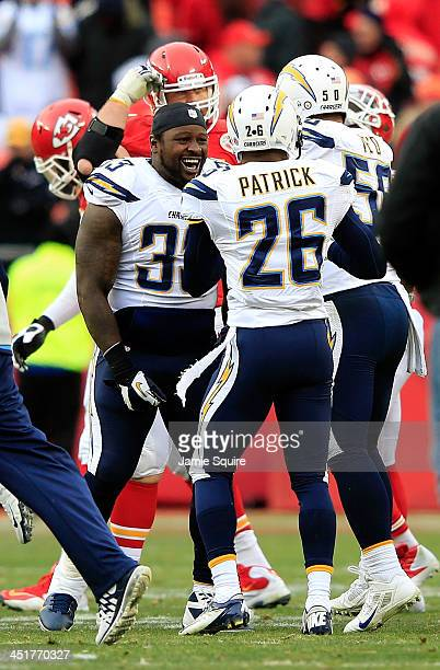 Fullback Le'Ron McClain of the San Diego Chargers celebrates with cornerback Johnny Patrick and inside linebacker Manti Te'o after the Chargers...