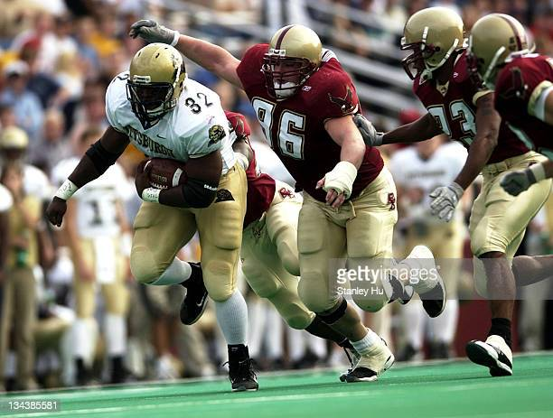 Fullback Lousaka Polite is pursued by David Kashetta of Boston College during Pittsburgh's 2413 victory over BC at Alumni Stadium in Newton...