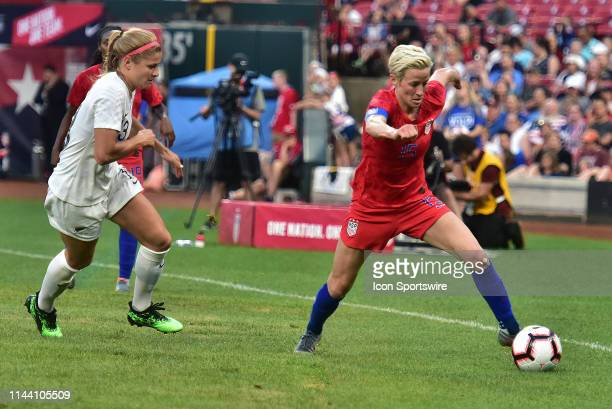 USA fullback Megan Rapinoe goes after the ball with New Zealand fullback Rosie White defending during a soccer game between the US Women's National...