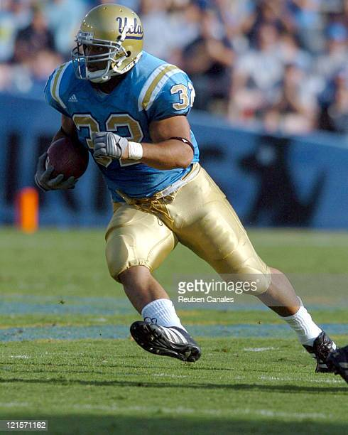 Fullback Michael Pitre of the UCLA Bruins runs upfield in a 27 to 7 win over the University of Arizona Wildcats on October 7 2006 at the Rose Bowl in...