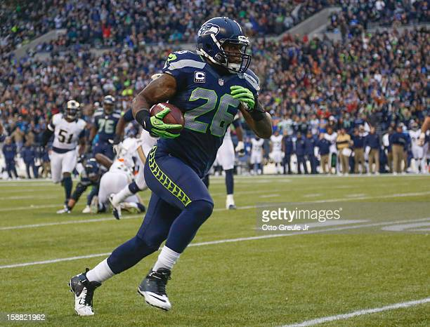 Fullback Michael Robinson of the Seattle Seahawks rushes for a touchdown in the third quarter against the St Louis Rams at CenturyLink Field on...