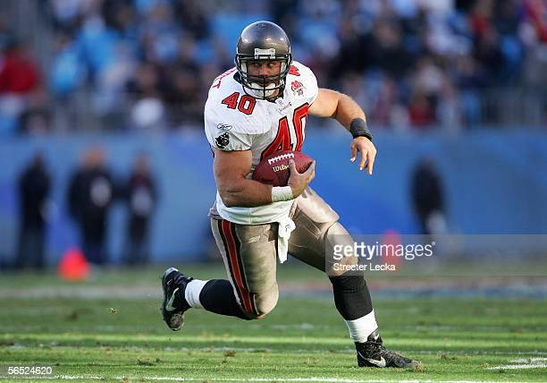 Fullback Mike Alstott of the Tampa Bay Buccaneers carries the ball against the Carolina Panthers at Bank of America Stadium on December 11 2005 in...