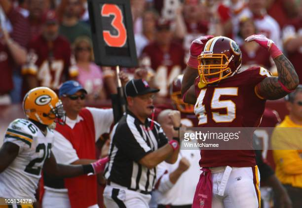 Fullback Mike Sellers of the Washington Redskins flexes after officials called a penalty on a key third down play in overtime against the Green Bay...