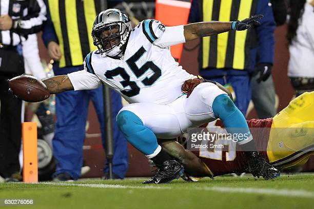 Fullback Mike Tolbert of the Carolina Panthers scores a third quarter touchdown past outside linebacker Martrell Spaight of the Washington Redskins...