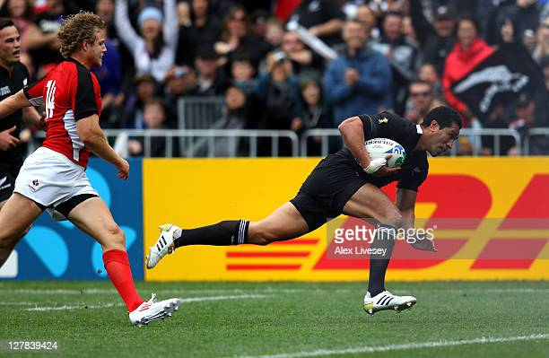 Fullback Mils Muliaina of the All Blacks dives over to score his team's fifth try during the IRB Rugby World Cup Pool A match between New Zealand and...