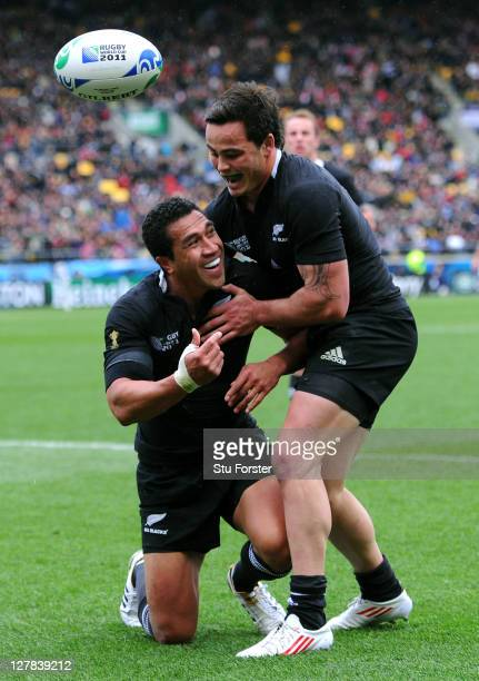 Fullback Mils Muliaina of the All Blacks is congratulated by teammate Zac Guildford after scoring his team's fifth try during the IRB Rugby World Cup...