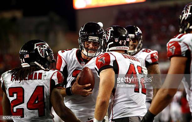 Fullback Patrick DiMarco of the Atlanta Falcons celebrates his touchdown with quarterback Matt Ryan and running back Devonta Freeman during the third...